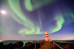 Farol de Gardur, aurora borealis, lua, Islândia Imagem de Stock Royalty Free