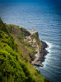 Farol do Arnel on Sao Miguel in the Azores. Beautiful lighthouse on Sao Miguel island in the Azores Royalty Free Stock Photo