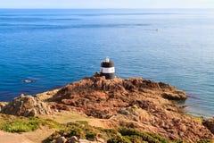 Farol do ponto de Noirmont, Jersey, consoles de canaleta Foto de Stock Royalty Free