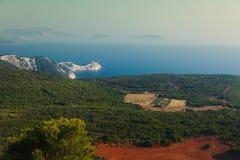 Farol durante o por do sol, cabo Doukato, ilha de Lefkada, Grécia fotografia de stock