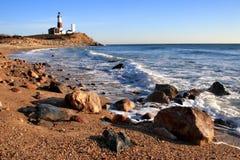 Farol e o oceano 2 Fotos de Stock
