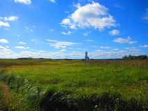 Farol em um campo, Prince Edward Island Canadá Imagem de Stock Royalty Free
