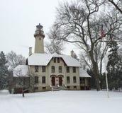 Farol em uma tempestade de neve Imagens de Stock