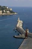 Farol na costa agradável do azur Foto de Stock Royalty Free
