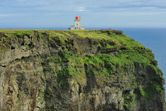 Farol na costa sul de Islândia Imagem de Stock