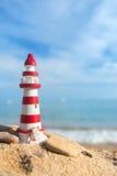 Farol na praia Fotos de Stock Royalty Free