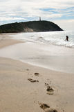 Farol na praia Foto de Stock Royalty Free