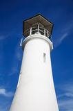 Farol no céu azul Foto de Stock Royalty Free