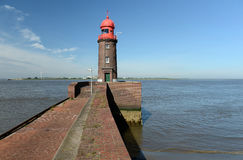 Farol no cais Foto de Stock Royalty Free