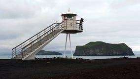 Farol no console de Heimaey, Islândia Fotografia de Stock