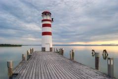 Farol no lago Neusiedl no por do sol Imagens de Stock Royalty Free