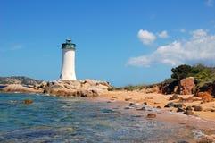 Farol no mar azul Imagem de Stock Royalty Free