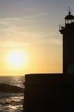 Farol no por do sol Fotos de Stock Royalty Free