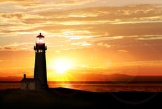 Farol no por do sol Foto de Stock Royalty Free