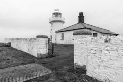 Farol Northumberland Inglaterra da ilha de Farne fotografia de stock
