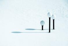 Farolas debajo de la nieve Fotografía de archivo libre de regalías