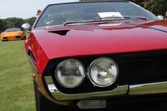 Faros clásicos del gemelo del coche de deportes Imágenes de archivo libres de regalías