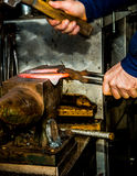 Farrier hammering horseshoe Royalty Free Stock Images