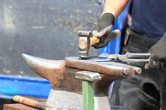 Farrier making a horseshoe Royalty Free Stock Images