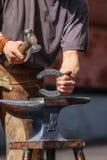 Farrier. Making horseshoe on anvil Royalty Free Stock Image