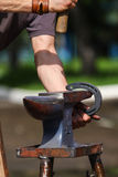 Farrier making horseshoe Stock Images