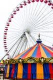 Farris hjul och utsmyckad karusell på marinpir Royaltyfria Foton