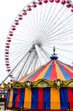 Farris Wheel and Ornate Carousel at the Navy Pier Royalty Free Stock Photos