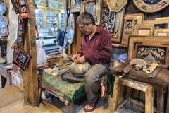 Workshop inside market, craftsman produces work of art, Shiraz, Royalty Free Stock Images
