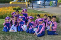 Group portrait of Iranian preschoolers in pink uniform, Shiraz,. Fars Province, Shiraz, Iran - 19 april, 2017: A group of children, boys and girls of pre-school Royalty Free Stock Photo