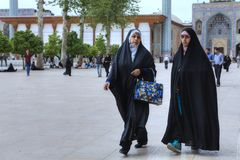 Women in Muslim clothes crossed courtyard of mosque, Shiraz, Ira Royalty Free Stock Photography