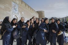 Schoolgirls near Karim Khan citadel, Shiraz, Iran. Fars Province, Shiraz, Iran - 19 april, 2017: Iranian schoolgirls are having fun and posing at the sight of a Stock Photography