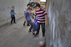 Iranian teenagers play football in the yard, Shiraz, Iran. Fars Province, Shiraz, Iran - 18 april, 2017: Iranian teenagers play in domestic football royalty free stock photography
