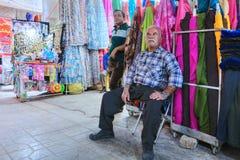 Sellers expect buyers in a textile shop, Shiraz, Iran. Stock Photos
