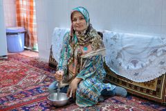 Muslim girl in hijab cooks meals at home. Stock Photos