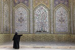 Woman wearing black khimar in courtyard  Regent Mosque, Shiraz, Stock Photos