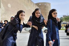 Iranian schoolgirls returned from excursion of Karim Khan Castle stock photos