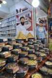 Iranian sweets traders stand near showcase of their store, Shira Royalty Free Stock Images