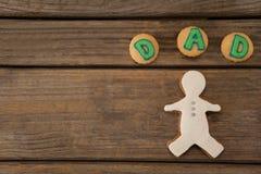 Farsatext som är skriftlig på kakor med pepparkakan Fotografering för Bildbyråer