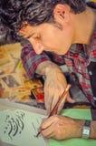 Farsi in Iran. Mobarakeh, Iran - circa June 2011: Native man writes text in Farsi, Persian language. Documentary editorial Royalty Free Stock Photos