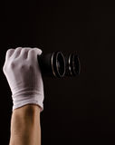 Farsightedness. Male hands with white gloves holding binoculars Stock Photo