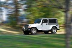 fartfylld jeep Arkivbild