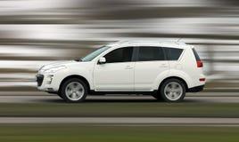 Fartfyllda SUV Fotografering för Bildbyråer