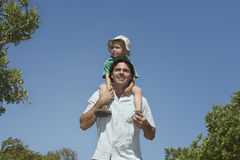 Farther Carrying Son On Shoulders Outdoors Stock Image