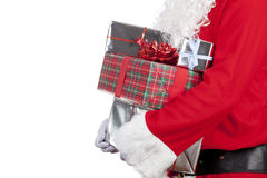 Farther christmas carrying a pile of wrapped christmas presents Stock Photography
