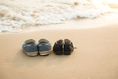 Farther's shoes and son's shoes on thes beac Royalty Free Stock Images