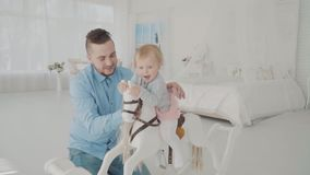 Farther swing his lovely daughter. Happy family. Slow motion.  stock video footage