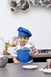 fartuch target1390_1_ błękitny chłopiec kapelusz trochę zdjęcia royalty free