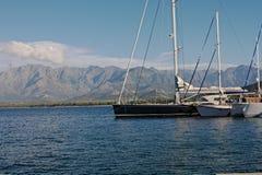 Fartyg i den Calvi hamnen Fotografering för Bildbyråer