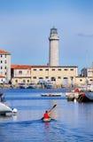 Fartygmarina och fyr i Trieste, Italien Royaltyfri Bild
