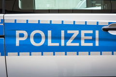 FAS réfléchi argenté bleu de police d'insigne de label de voiture de Polizei d'Allemand Image stock